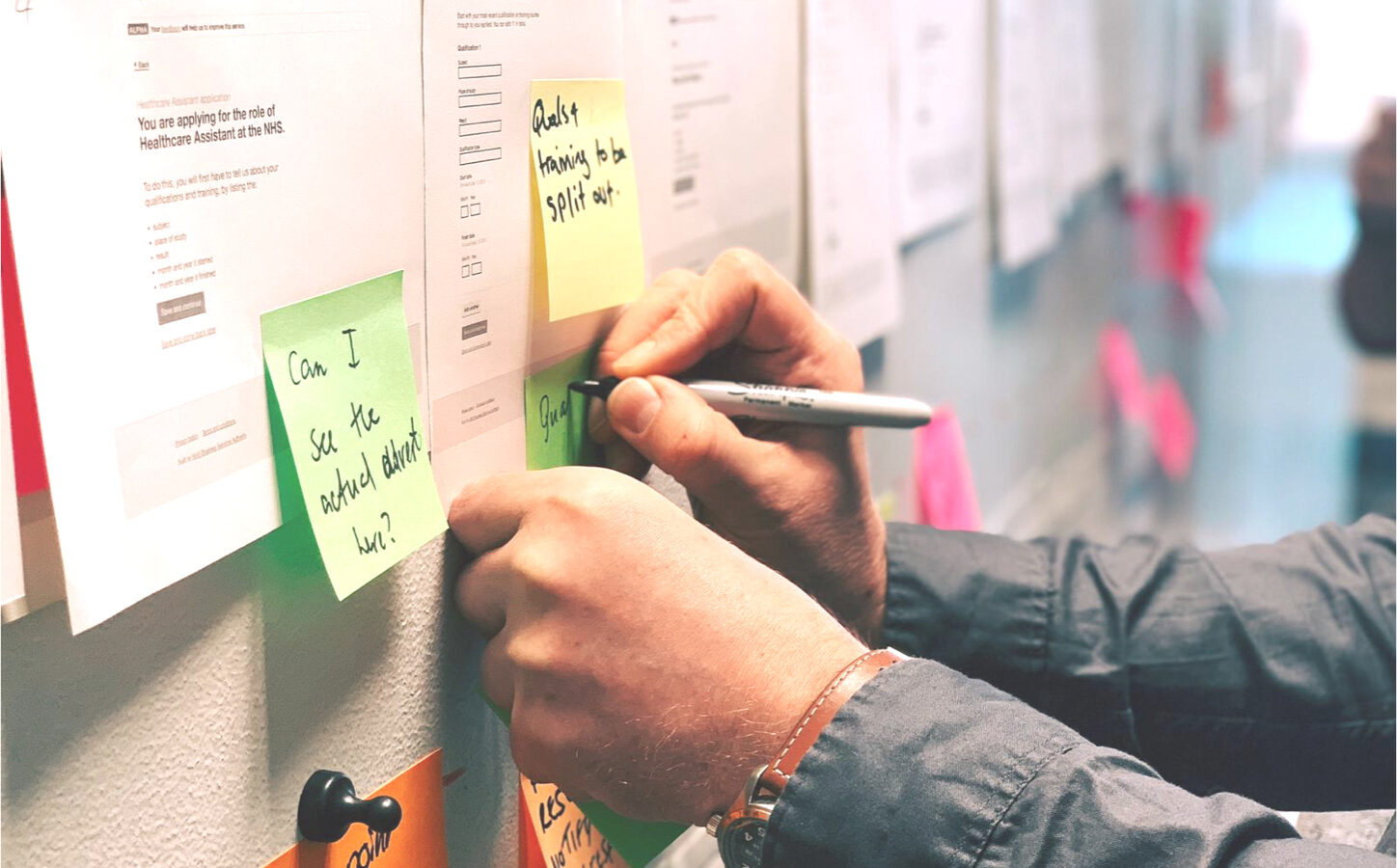 Member of the team writing on post it notes