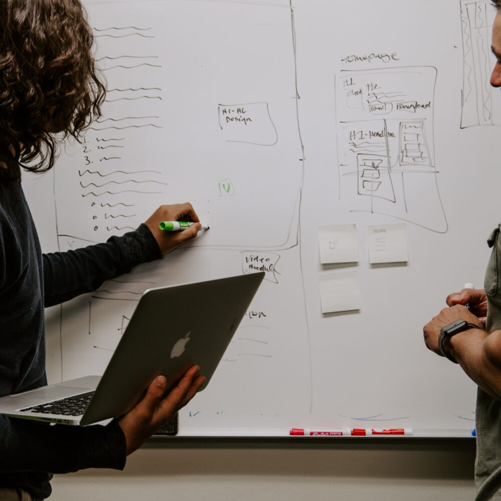 Image: Business Architecture: a powerful way to navigate change- 'drawing plans on whiteboard'
